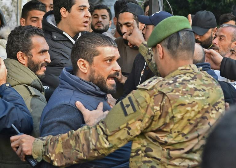 Lebanese Sunni Muslims argue the PM-designate does not have their backing for a post reserved for Sunnis by a power-sharing system enshrined after the 1975-1990 civil war (AFP Photo/-)