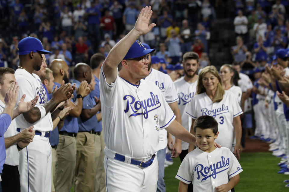 Kansas City Royals manager Ned Yost (3) waves to the crowd during a ceremony before a baseball game against the Minnesota Twins at Kauffman Stadium in Kansas City, Mo., Friday, Sept. 27, 2019. Yost will retire after Sunday's game. (AP Photo/Orlin Wagner)