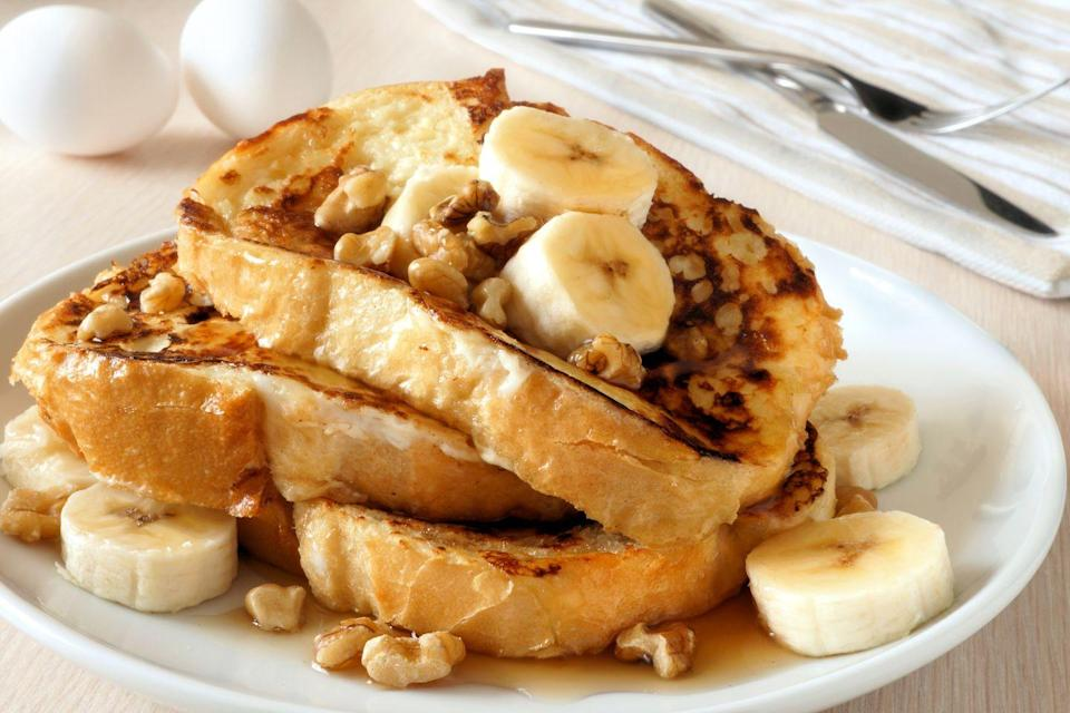 """<p>Do all the breakfast prep of this classic brunch recipe the night before, save half the time in a busy weekend morning! Sliced almonds or chopped walnuts add a lovely crunch to an otherwise velvety bite. </p><p><em><a href=""""https://www.goodhousekeeping.com/food-recipes/a4026/syrupy-banana-nut-overnight-french-toast-1006/"""" rel=""""nofollow noopener"""" target=""""_blank"""" data-ylk=""""slk:Get the Syrupy Banana-Nut Overnight French Toast recipe »"""" class=""""link rapid-noclick-resp"""">Get the Syrupy Banana-Nut Overnight French Toast recipe »</a></em></p><p><strong>RELATED: </strong><a href=""""https://www.goodhousekeeping.com/food-recipes/g4201/best-brunch-recipes/"""" rel=""""nofollow noopener"""" target=""""_blank"""" data-ylk=""""slk:55 Delicious Brunch Recipes to Make This Weekend"""" class=""""link rapid-noclick-resp"""">55 Delicious Brunch Recipes to Make This Weekend</a></p>"""