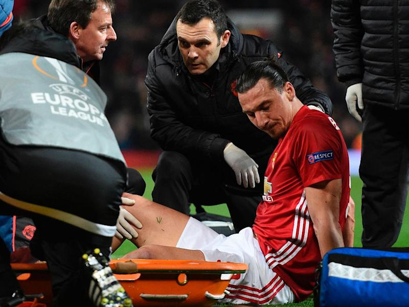 Zlatan Ibrahimovic has to be taken off after suffering the knee injury (Getty)