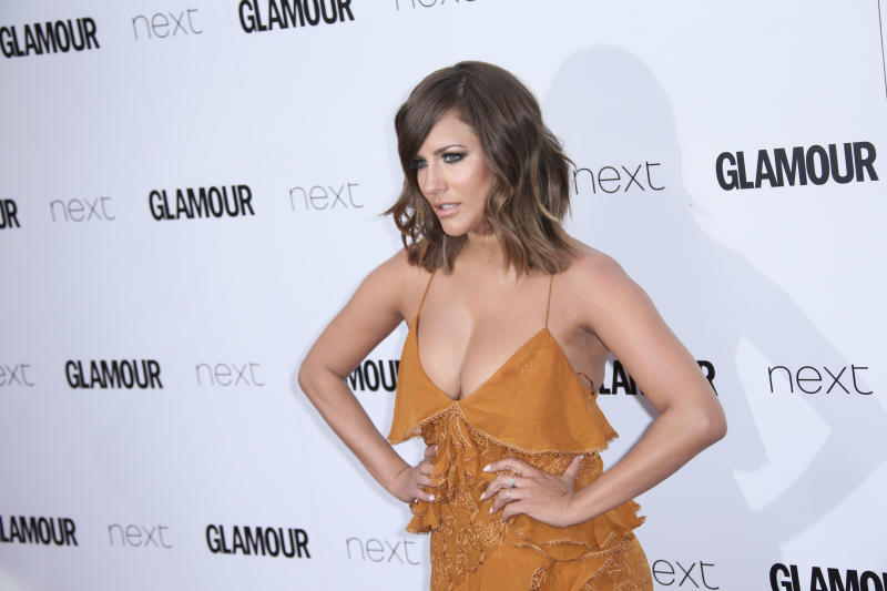 Presenter Caroline Flack poses for photographers upon arrival at the Glamour Woman of the Year Awards in London, Tuesday, June 6, 2017. (Photo by Joel Ryan/Invision/AP)