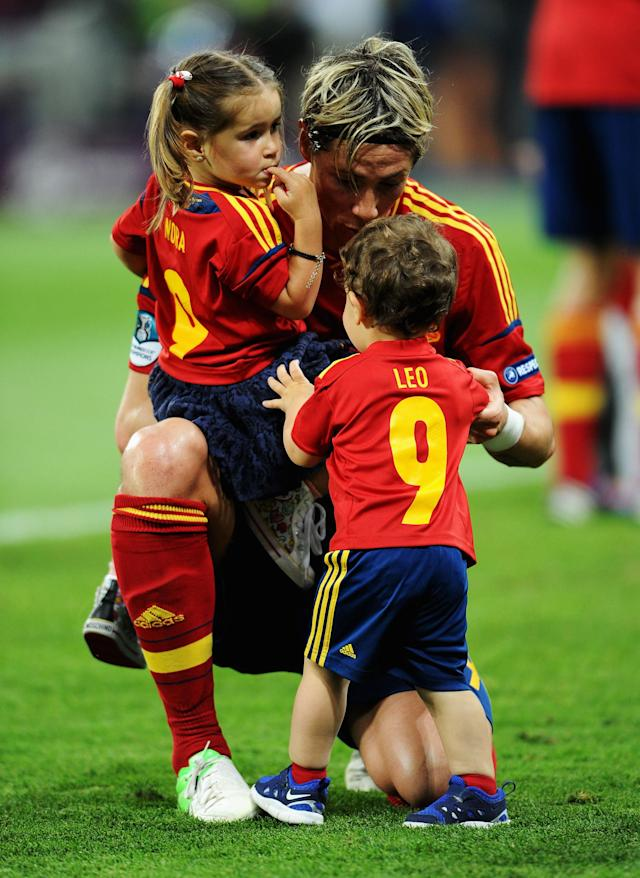 KIEV, UKRAINE - JULY 01: Fernando Torres of Spain speaks with his children Nora Torres (L) and Leo Torres (R) after the UEFA EURO 2012 final match between Spain and Italy at the Olympic Stadium on July 1, 2012 in Kiev, Ukraine. (Photo by Jasper Juinen/Getty Images)