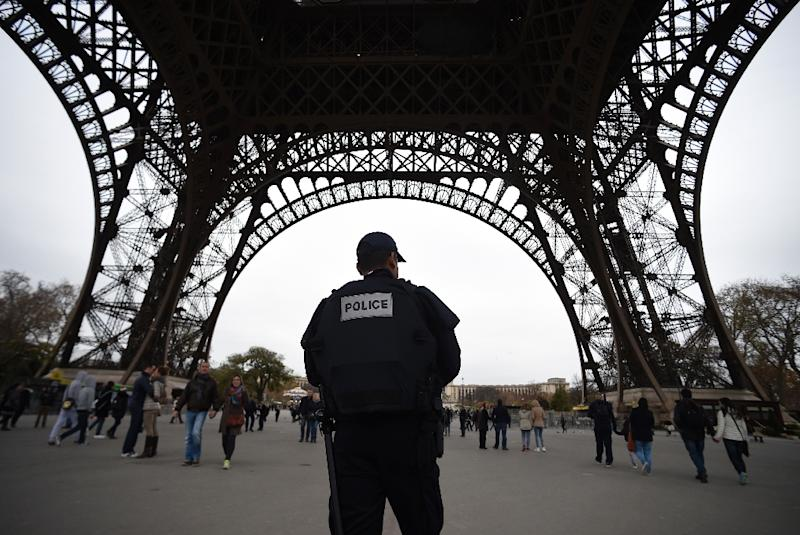 Police patrol in Paris on November 14, 2015 at the Eiffel Tower