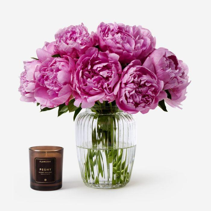 "Peony season is short but sweet, so surprise mom with these fresh blooms while you still can. The vibrant fuchsia hue will add a pop of color wherever she puts them, and the symbolism is on-point too—it represents good fortune. Flowerbx currently delivers in Los Angeles, Manhattan, and the Hamptons, and next-day delivery is available on orders before 1 p.m. ET. $185, Carnival Peony. <a href=""https://www.flowerbx.com/us/carnival-peony"" rel=""nofollow noopener"" target=""_blank"" data-ylk=""slk:Get it now!"" class=""link rapid-noclick-resp"">Get it now!</a>"