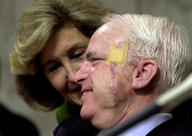 <p>Recovering from skin cancer surgery, Sen. John McCain talks with Sen. Kay Bailey Hutchinson on Capitol Hill, Sept. 12, 2000, during the Senate Commerce Committee on the Firestone tire recall. (Photo: Dennis Cook/AP) </p>