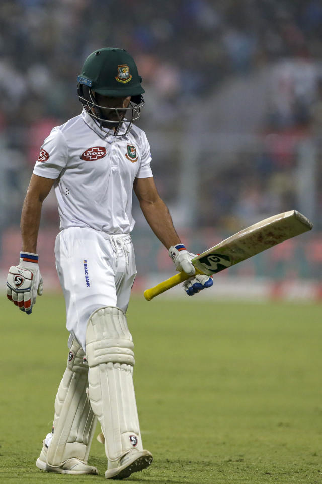 Bangladesh's captain Mominul Haque walks back to the pavilion after being dismissed during the second day of the second test cricket match between India and Bangladesh, in Kolkata, India, Saturday, Nov. 23, 2019. (AP Photo/Bikas Das)