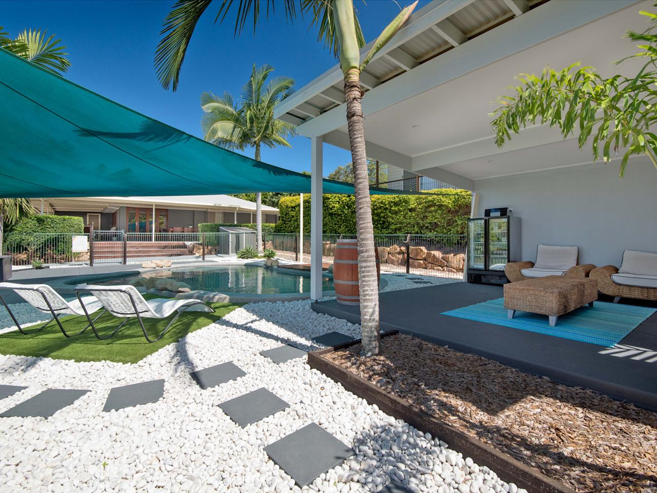 <p>Set in 1.5 acres, 9 Parakeet Court in Warner, has a swimming pool and sun terrace that could have been plucked right off the pages of holiday brochure advertising a luxury hotel and spa resort. There's even a self-contained one bedroom granny flat with its own veranda overlooking the pool in the grounds. </p>
