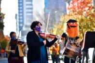 A band featuring Gritty, the Philadelphia Flyers hockey team mascot, plays in celebration after Democratic presidential nominee Joe Biden overtook President Donald Trump in the Pennsylvania general election vote in Philadelphia