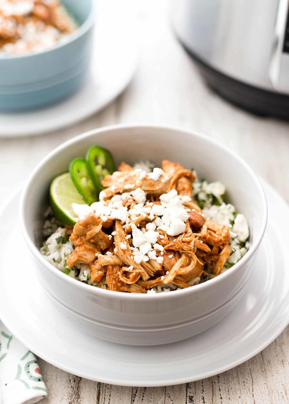 """<strong>Get the <a href=""""https://www.simplyrecipes.com/recipes/pressure_cooker_chipotle_chicken_and_rice_bowls/"""" target=""""_blank"""">Pressure Cooker Chipotle Chicken and Rice Bowls</a> recipe from Simply Recipes</strong>"""