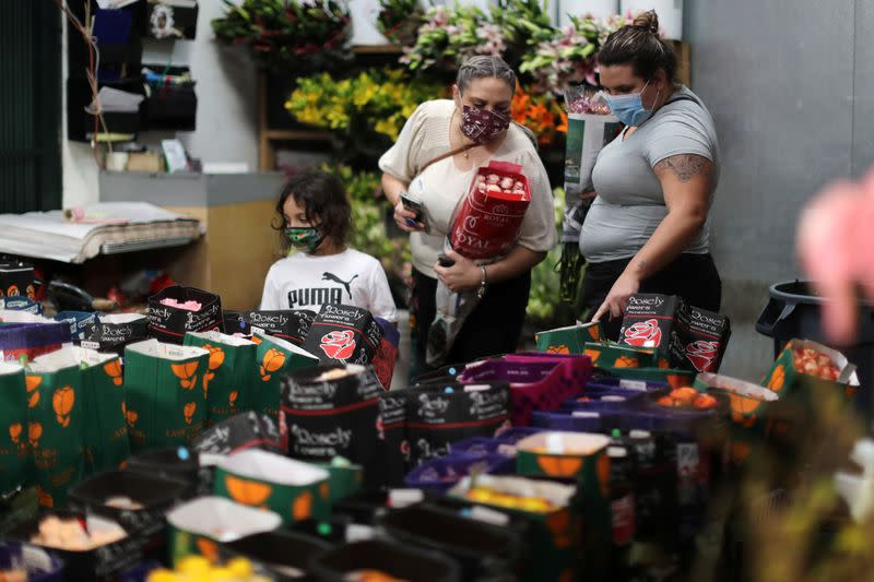 People shop for flowers at the California Flower Mall in Los Angeles