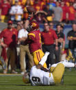 Southern California quarterback Cody Kessler, top, passes as Notre Dame linebacker Jaylon Smith drags him down during the first half of an NCAA college football game, Saturday, Nov. 29, 2014, in Los Angeles. (AP Photo/Mark J. Terrill)