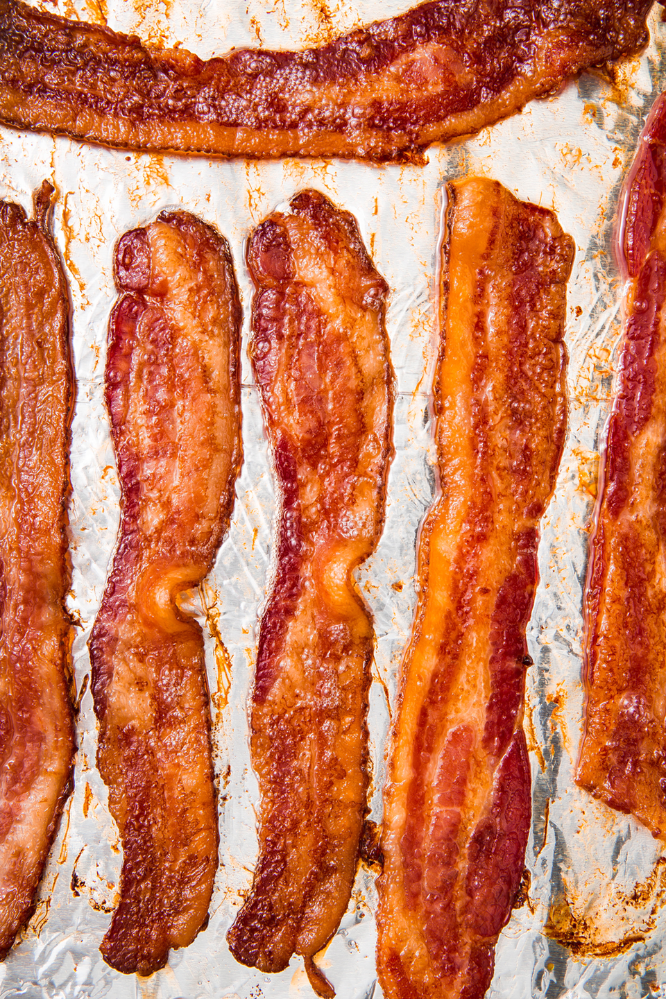 "<p>There is no better way to cook bacon.</p><p>Get the recipe from <a href=""https://www.delish.com/cooking/a22502749/how-to-cook-bacon-in-the-oven-recipe/"" rel=""nofollow noopener"" target=""_blank"" data-ylk=""slk:Delish"" class=""link rapid-noclick-resp"">Delish</a>.</p>"