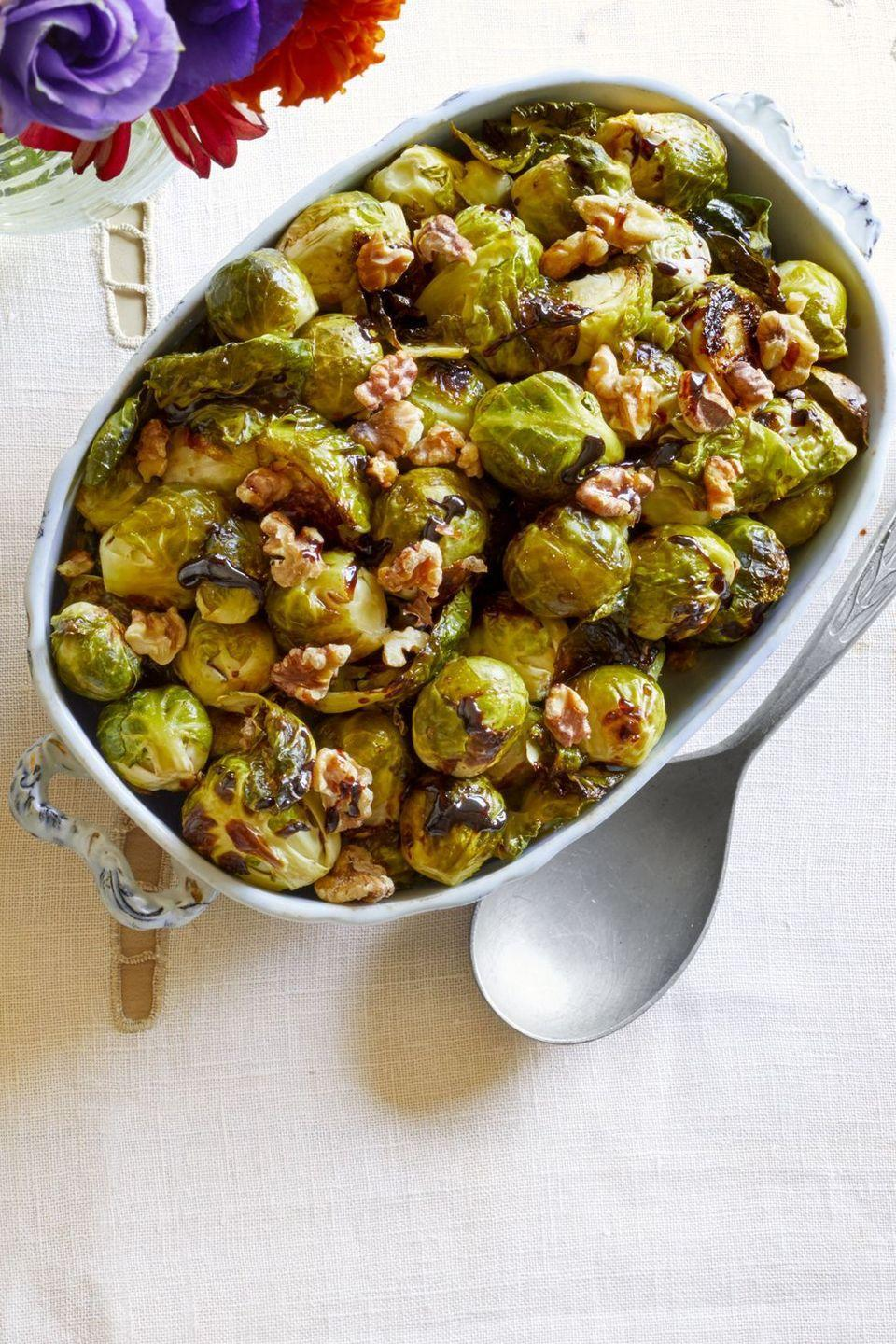 """<p>Boil balsamic vinegar with sugar and drizzle over roasted sprouts for a super-simple side. And don't forget the toasted walnuts!</p><p><strong><a href=""""https://www.thepioneerwoman.com/food-cooking/recipes/a33249425/brussels-sprouts-with-balsamic-reduction-walnuts-recipe/"""" rel=""""nofollow noopener"""" target=""""_blank"""" data-ylk=""""slk:Get Ree's recipe."""" class=""""link rapid-noclick-resp"""">Get Ree's recipe.</a></strong></p>"""