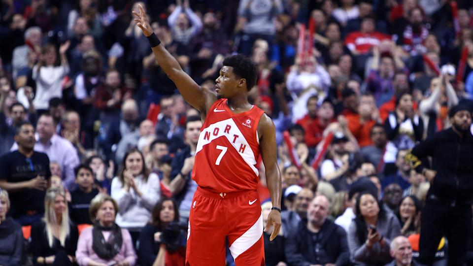 TORONTO, ON - JANUARY 17:  Kyle Lowry #7 of the Toronto Raptors waves to fans after he reached his 5,000 career assist early in the second half of an NBA game against the Phoenix Suns at Scotiabank Arena on January 17, 2019 in Toronto, Canada.  NOTE TO USER: User expressly acknowledges and agrees that, by downloading and or using this photograph, User is consenting to the terms and conditions of the Getty Images License Agreement.  (Photo by Vaughn Ridley/Getty Images)