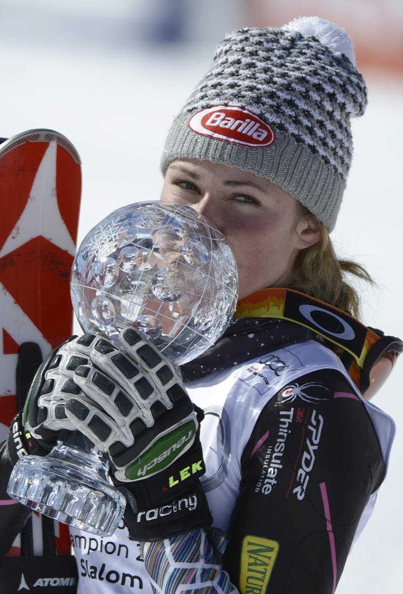 Mikaela Shiffrin of the US kisses the crystal globe as the winner of the overall women's slalom  World Cup at the Alpine Ski World Cup finals in Parpan - Lenzerheide, Switzerland, Saturday, March 16, 2013. (AP Photo/Keystone, Laurent Gillieron)