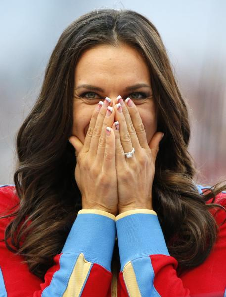 Russia's Yelena Isinbayeva reacts as she stands on the podium after receiving the gold medal in the women's pole vault during the medal ceremony at the World Athletics Championships in the Luzhniki stadium in Moscow, Russia, Thursday, Aug. 15, 2013. (AP Photo/Alexander Zemlianichenko)