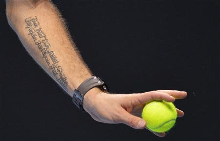 A tattoo reading 'Ever tried. Ever failed. No matter. Try again. Fail again. Fail better.' is seen on the arm of Stanislas Wawrinka of Switzerland as he serves during his ATP World Tour Finals men's singles tennis match against Tomas Berdych of the Czech Republic at the O2 Arena in London, November 4, 2013. REUTERS/Toby Melville