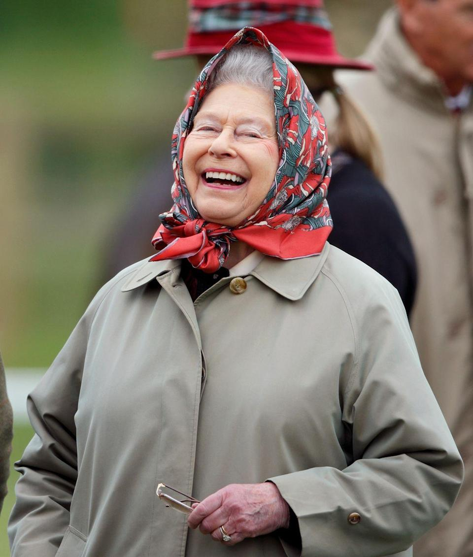 "<p>When Queen Elizabeth is off-duty, she trades in her tiaras for silk headscarves. The monarch has a large array of <a href=""https://www.townandcountrymag.com/style/fashion-trends/g22550728/queen-elizabeth-headscarf-photos/"" rel=""nofollow noopener"" target=""_blank"" data-ylk=""slk:colorfully printed scarves"" class=""link rapid-noclick-resp"">colorfully printed scarves</a>, and she almost always pairs them with a khaki or green army jacket. </p>"