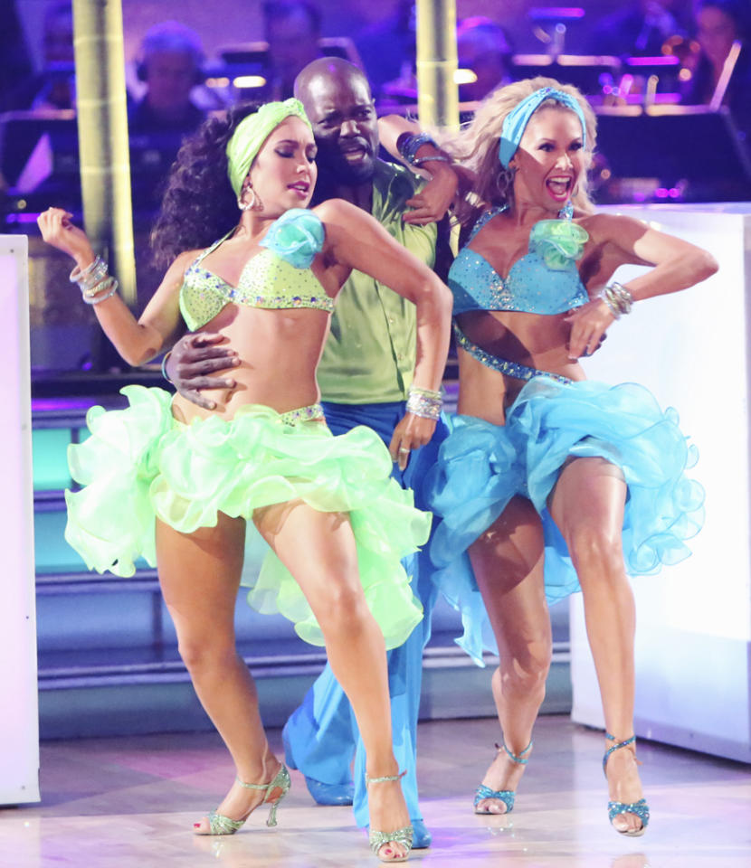 "Cheryl Burke, Emmitt Smith and Kym Johnson perform on ""Dancing With the Stars: All-Stars."""