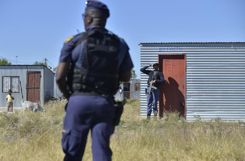 File picture shows policemen patrolling an area in Rustenburg, South Africa on April 30, 2014 during a visit by the police minister