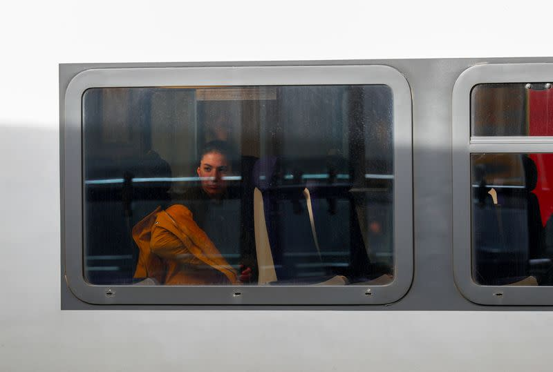 A passenger is pictured in a train at Luxembourg railway station