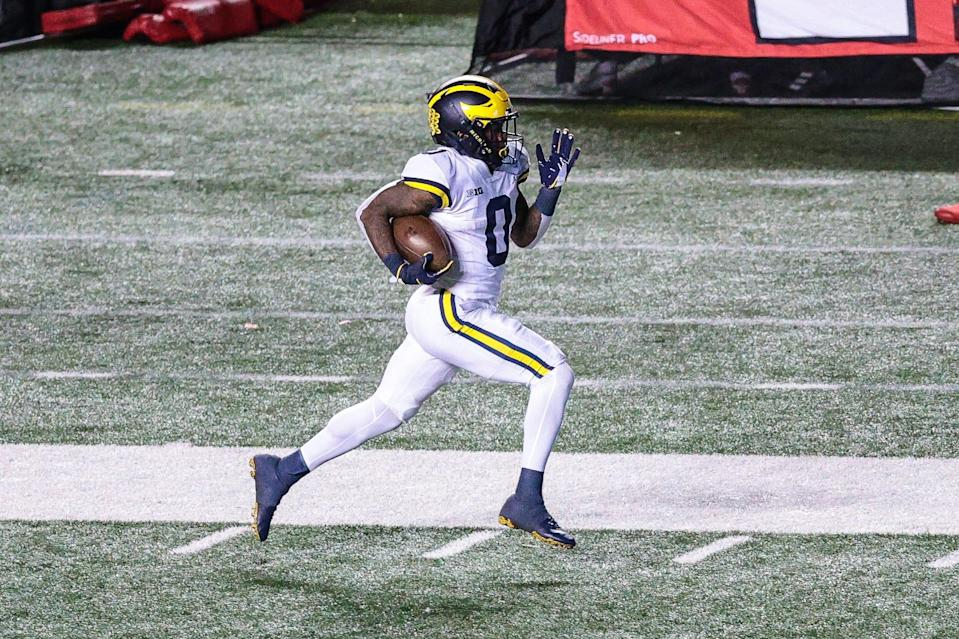 Michigan Wolverines wide receiver Giles Jackson (0) returns a kickoff for a touchdown during the third quarter against the Rutgers Scarlet Knights Nov. 22, 2020, at SHI Stadium.