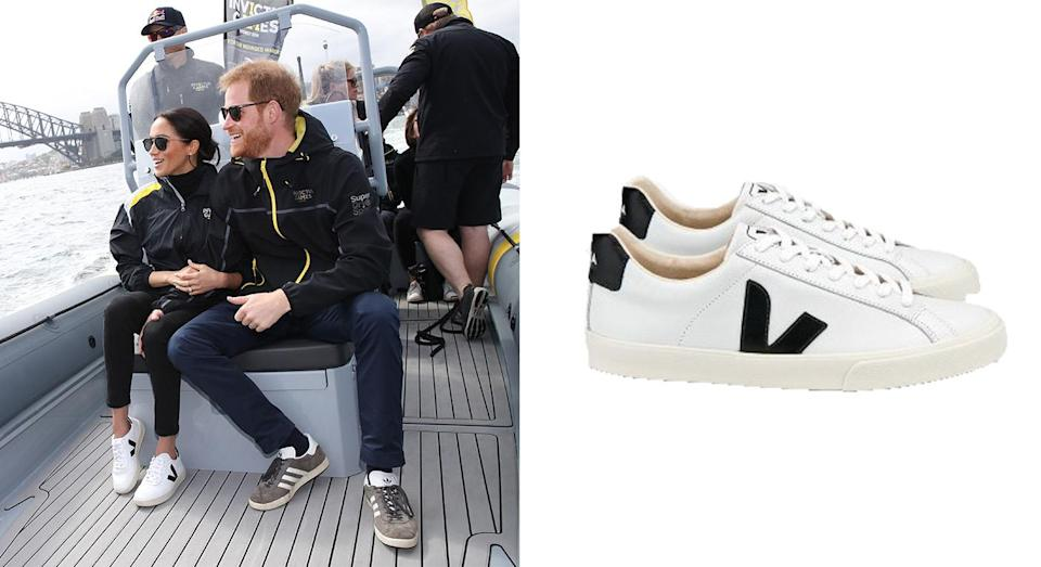 """<p>The Duchess later changed into a more appropriate look for an afternoon boat trip, as she looked to the street style set's go-to trainer for assistance. Yes, Meghan wore a pair of £114 Veja trainers and now we're in desperate need a pair. <a rel=""""nofollow noopener"""" href=""""https://www.zalando.co.uk/veja-v10-leather-trainers-vj212b01a-a11.html"""" target=""""_blank"""" data-ylk=""""slk:Shop now"""" class=""""link rapid-noclick-resp""""><strong>Shop now</strong></a>. <em>[Photo: Getty]</em> </p>"""