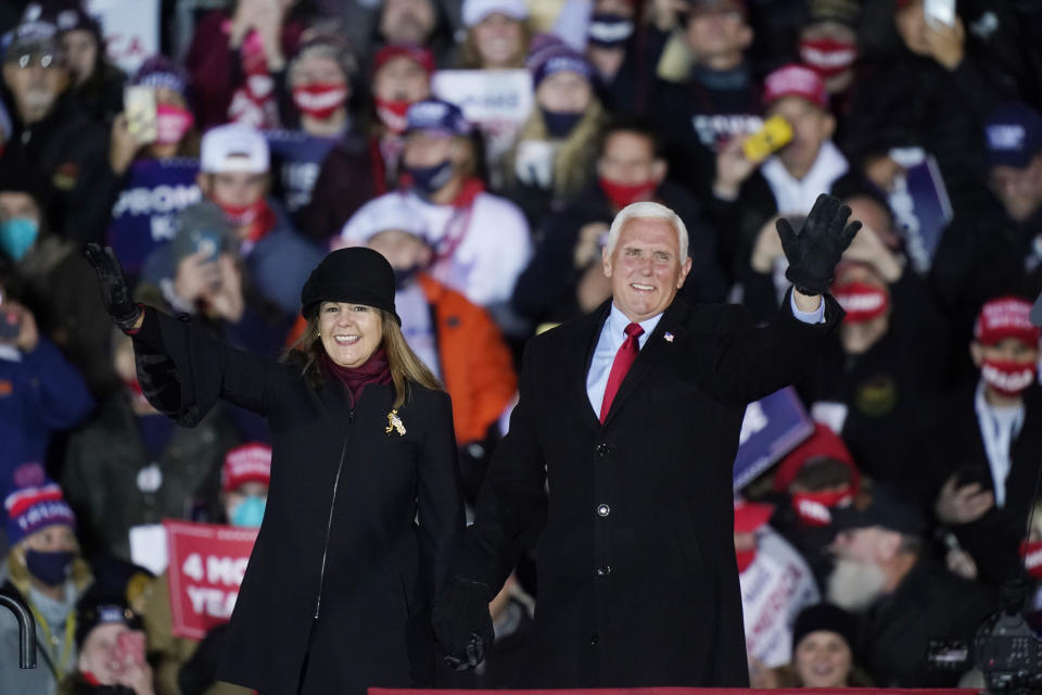 Vice President Mike Pence and his wife Karen wave before the vice president speaks during a campaign event, Monday, Nov. 2, 2020, in Grand Rapids, Mich. (AP Photo/Carlos Osorio)