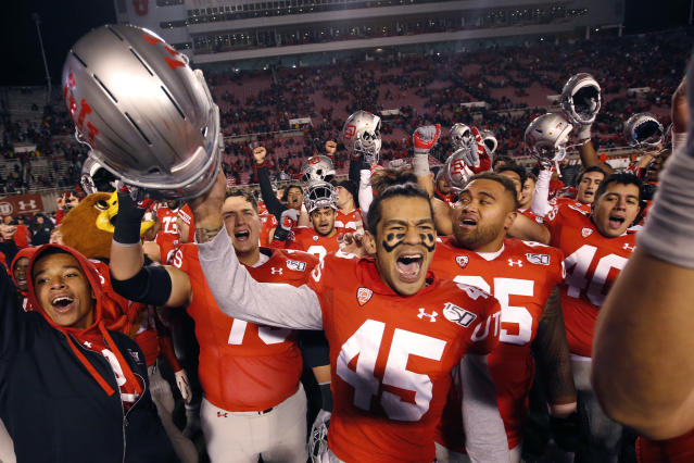 Utah wide receiver Samson Nacua (45) celebrates with his teammates after their victory over Colorado during an NCAA college football game Saturday, Nov. 30, 2019, in Salt Lake City. (AP Photo/Rick Bowmer)
