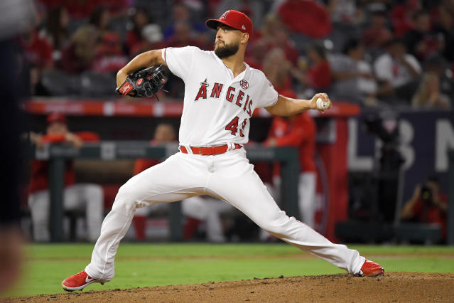 Los Angeles Angels starting pitcher Patrick Sandoval throws to the plate during the second inning of a baseball game against the Houston Astros, Friday, Sept. 27, 2019, in Anaheim, Calif. (AP Photo/Mark J. Terrill)