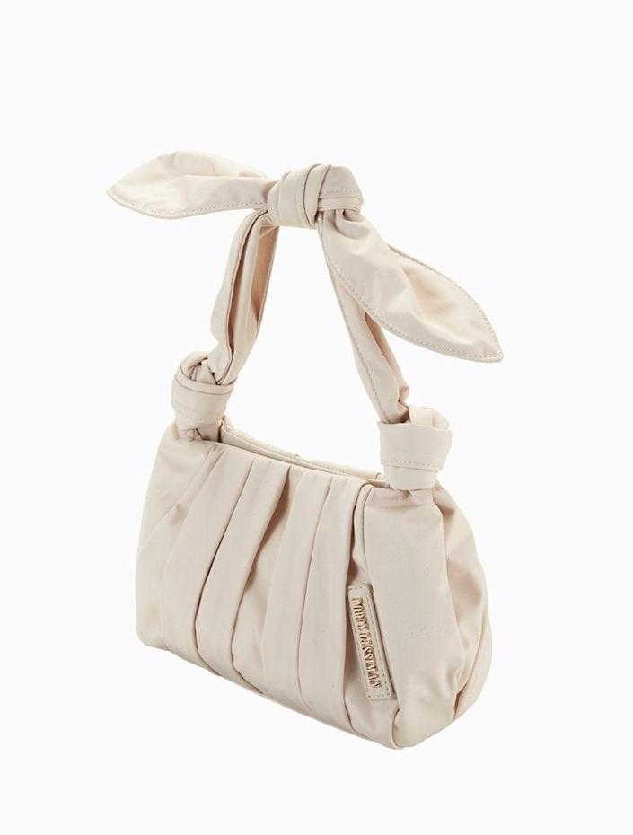 """<br><br><strong>Poppy Lissiman</strong> Knot Croissant Bag, $, available at <a href=""""https://go.skimresources.com/?id=30283X879131&url=https%3A%2F%2Fus.poppylissiman.com%2Fproducts%2Fbags%2Fknot-croissant-blanc"""" rel=""""nofollow noopener"""" target=""""_blank"""" data-ylk=""""slk:Poppy Lissiman"""" class=""""link rapid-noclick-resp"""">Poppy Lissiman</a>"""
