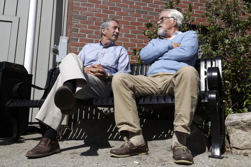 Republican presidential candidate former South Carolina Gov. Mark Sanford, left, chats with Ken Demick, of Manchester, N.H., as he campaigns, Thursday, Sept. 19, 2019, in Manchester. (AP Photo/Elise Amendola)