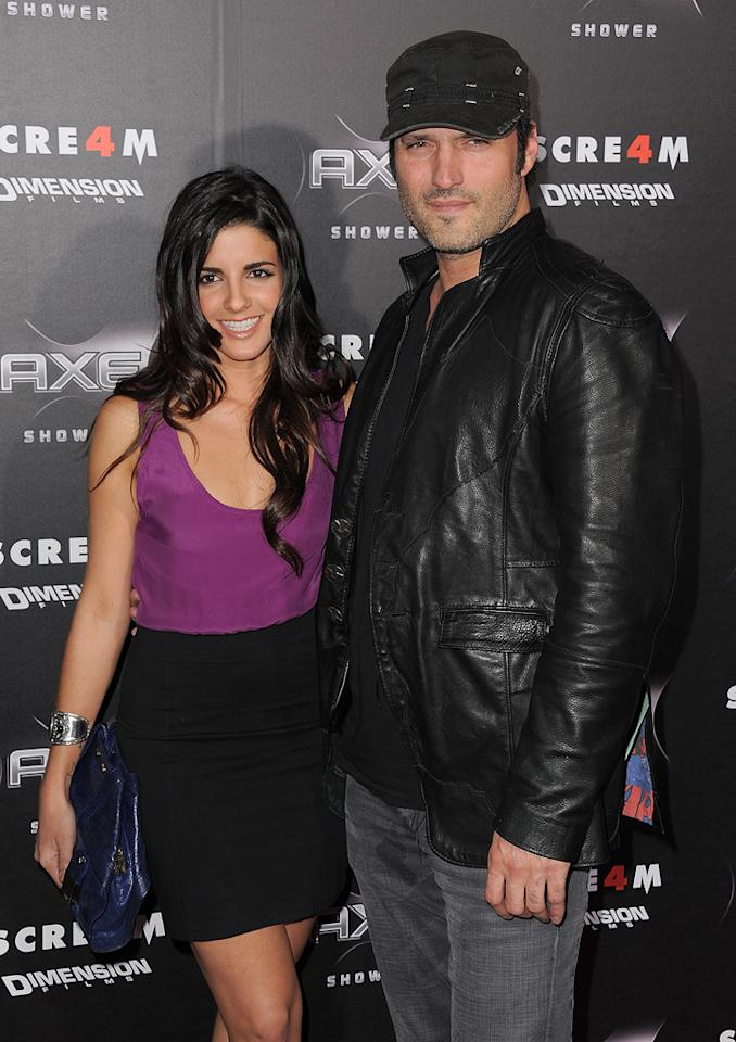 """Director <a href=""""http://movies.yahoo.com/movie/contributor/1800021941"""">Robert Rodriguez</a> (""""Machete"""") and his latest piece of arm candy struck a pose for the swarming photographers."""