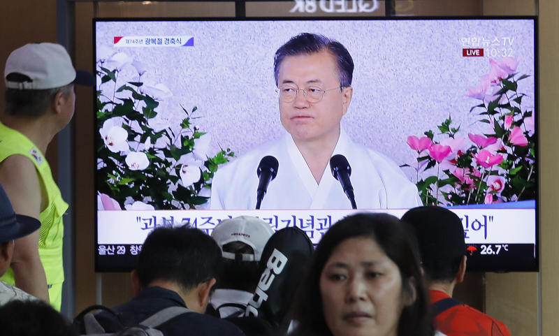 "People watch a TV screen showing a live broadcast of South Korean President Moon Jae-in's speech during a ceremony to celebrate the Korean Liberation Day, marking the 74th anniversary of Korea's liberation from the Japanese colonial rule, at the Seoul Railway Station in Seoul, South Korea, Thursday, Aug. 15, 2019. The signs read: ""Korean Liberation Day.""(AP Photo/Ahn Young-joon)"