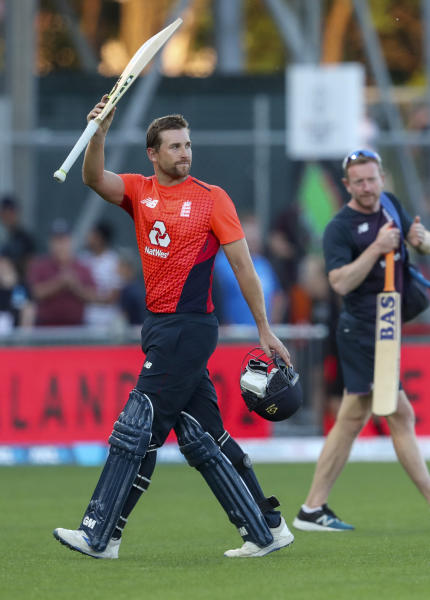 England's David Milan acknowledges the crowd after hitting 103 not out during the T20 cricket match between England and New Zealand in Napier, New Zealand, Friday, Nov. 8, 2019. (John Cowpland/Photosport via AP)