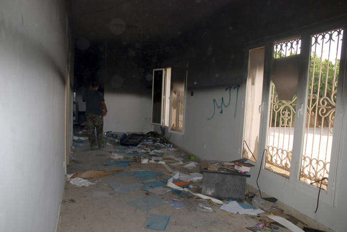 """FILE - This Sept. 12, 2012 file photo shows a man walking through a room in the gutted U.S. consulate in Benghazi, Libya, after an attack that killed four Americans, including Ambassador Chris Stevens. Leaders of a House committee said Tuesday that U.S. diplomats in Libya made repeated requests for increased security for the consulate in Benghazi and were turned down by officials in Washington. In a letter to Secretary of State Hillary Rodham Clinton, Chairman Darrell Issa and Rep. Jason Chaffetz said their information came from """"individuals with direct knowledge of events in Libya."""" (AP Photo/Ibrahim Alaguri, File)"""