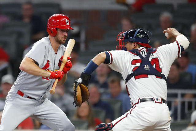 Atlanta Braves catcher Kurt Suzuki (24) throws to second for the out on St. Louis Cardinals' Kolten Wong as Austin Gomber bats during the third inning of a baseball game Tuesday, Sept. 18, 2018, in Atlanta. (AP Photo/Todd Kirkland)