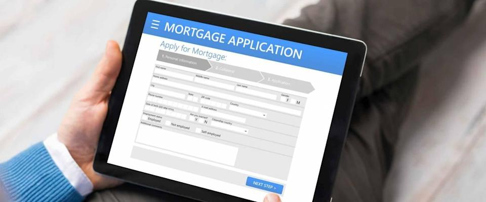 Man filling out mortgage application online