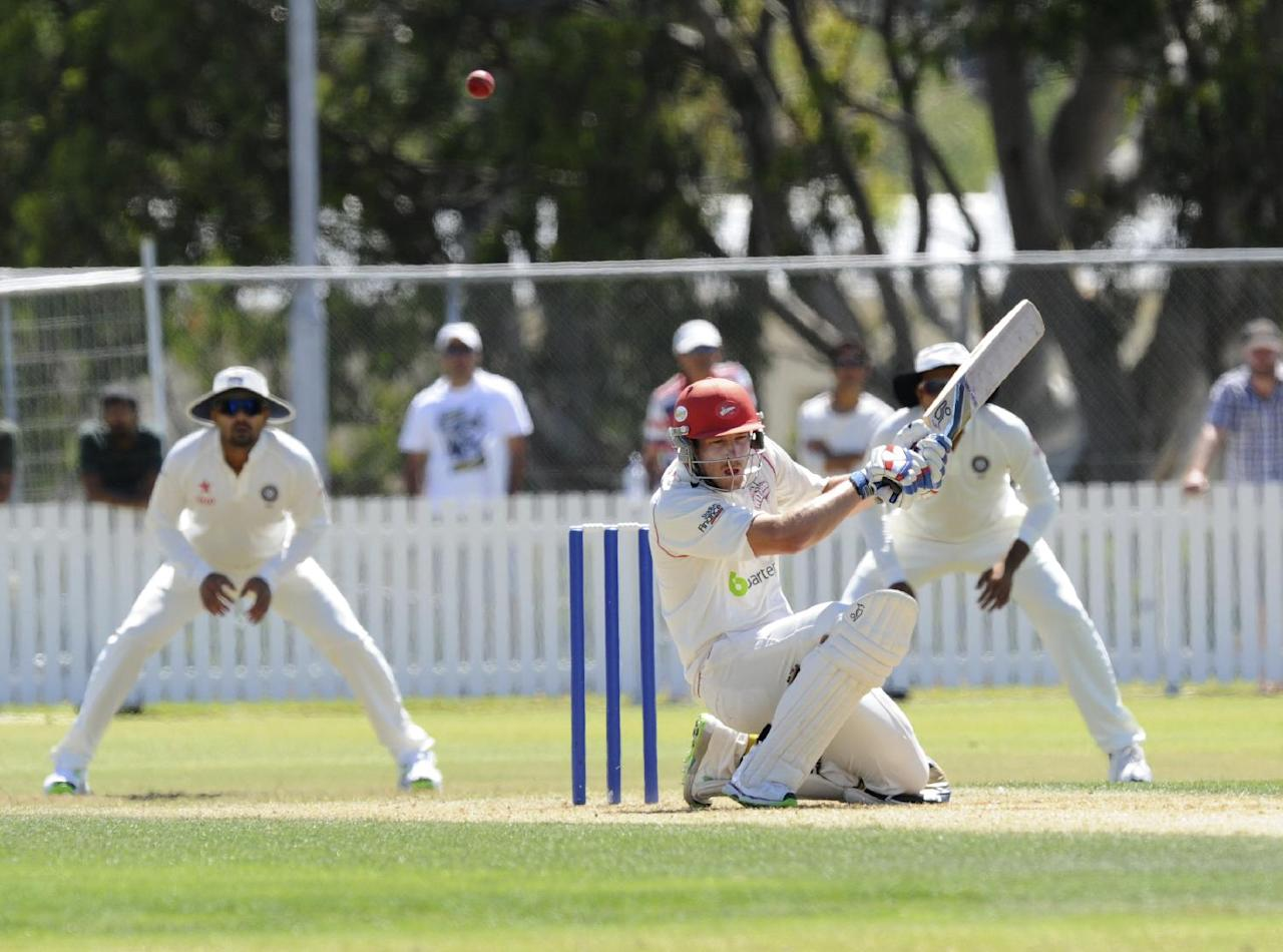 New Zealand XI's George Walker ducks against bouncer against India on the first day of a pre test warm up cricket match at Cobham Oval in Whangarei, New Zealand, Sunday, Feb. 2, 2014. (AP Photo/SNPA, Ross Setford) NEW ZEALAND OUT