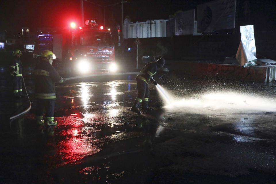 Afghan firefighters spray water at the scene of a bombing attack in Kabul, Afghanistan, Wednesday, April 21, 2021. An explosion in the Afghan capital Wednesday wounded at least five people, said an Afghan interior ministry official. (AP Photo/Rahmat Gul)