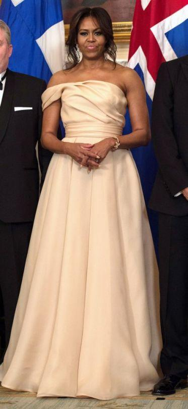 <p>At a state dinner for Denmark, Finland, Iceland, Norway, and Sweden in May, the first lady called on one of her favorite designers, Naeem Khan, to make her a champagne-colored off-the-shoulder gown. (Photo: AP) </p>