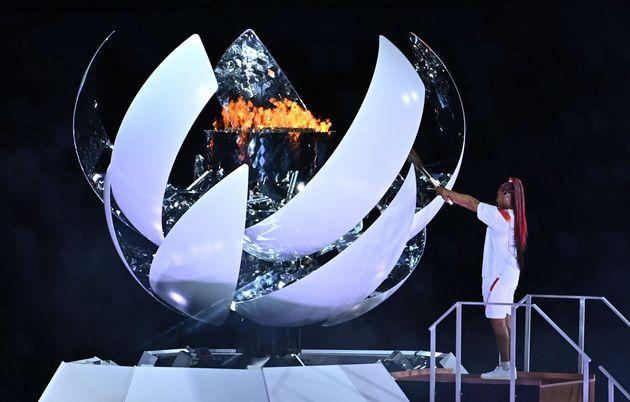 Japanese tennis player Naomi Osaka lights the flame of hope in the Olympic Cauldron during the opening ceremony of the Tokyo 2020 Olympic Games. (Photo: BEN STANSALL via Getty Images)
