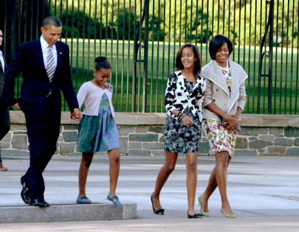 Frist lady Michelle Obama, Malia Obama, Sasha Obama, and U.S. President Barack Obama walk across LaFayette Park to St. John's Episcopal Church on September 19, 2010 in Washington, DC. The President has no public events scheduled for today. (Photo by Dennis Brack-Pool/Getty Images)