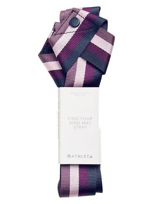 """<h3>Yoga Mat Strap</h3> <br>A yoga strap can help target and deepen your cool-down stretches (it's a game-changer for hamstrings) to improve flexibility. Bonus: This Athleta one can also be used to hold your mat when you're all done.<br><br><strong>Athleta</strong> Find your Bind Mat Strap, $, available at <a href=""""https://go.skimresources.com/?id=30283X879131&url=https%3A%2F%2Fathleta.gap.com%2Fbrowse%2Fproduct.do%3Fpid%3D530602012%26vid%3D1%26tid%3Datpl000037"""" rel=""""nofollow noopener"""" target=""""_blank"""" data-ylk=""""slk:Athleta"""" class=""""link rapid-noclick-resp"""">Athleta</a><br>"""