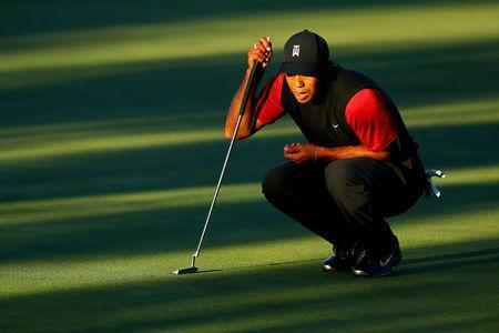 FILE PHOTO: Nov 23, 2018; Las Vegas, NV, USA; Tiger Woods lines up a putt on the 16th green during The Match: Tiger vs Phil golf match at Shadow Creek Golf Course. Mandatory Credit: Rob Schumacher-USA TODAY Sports/File Photo