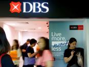 FILE PHOTO: FILE PHOTO: People walk past a DBS branch in Singapore