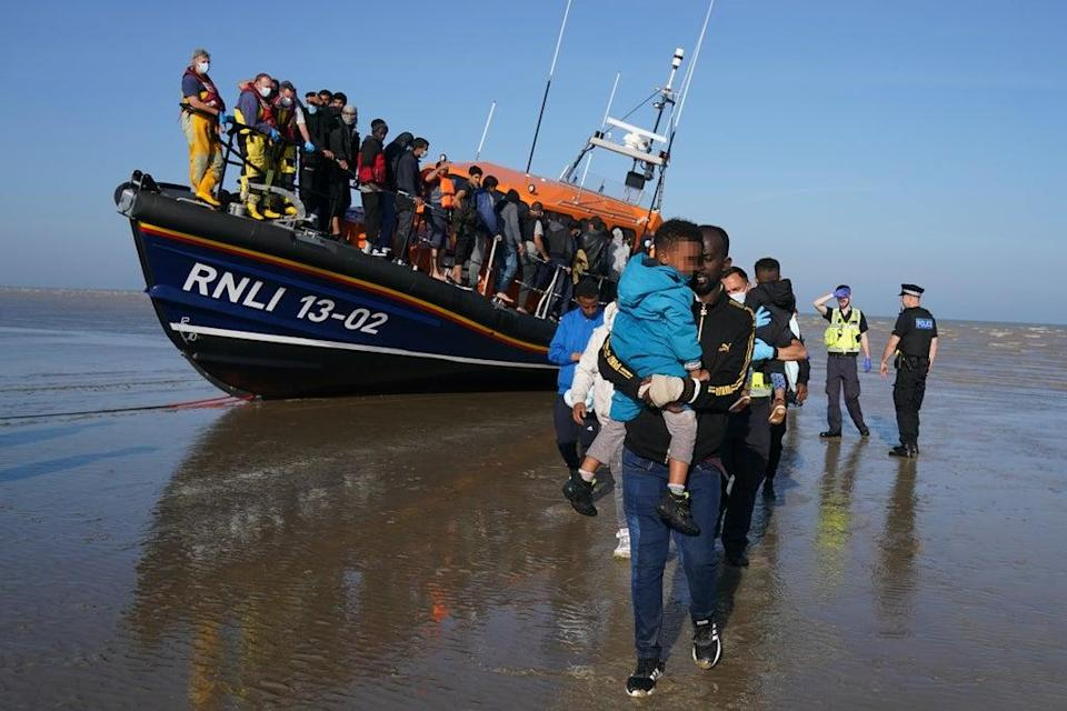 A group of people thought to be migrants are brought ashore at Dungeness in Kent (Gareth Fuller/PA) (PA Wire)