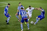 -Real Madrid's Karim Benzema, second right, vies for the ball surrounded with Alaves players during the Spanish La Liga soccer match between Alaves and Real Madrid at Mendizorroza stadium in Vitoria, Spain, Saturday, Jan. 23, 2021. (AP Photo/Alvaro Barrientos)