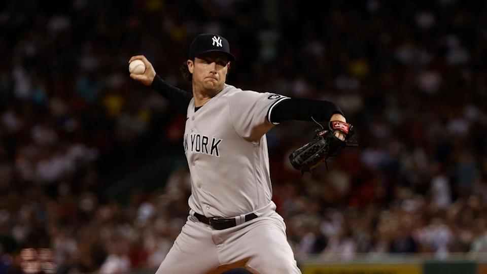 Gerrit Cole throws pitch vs. Red Sox at Fenway Park in grey uniform