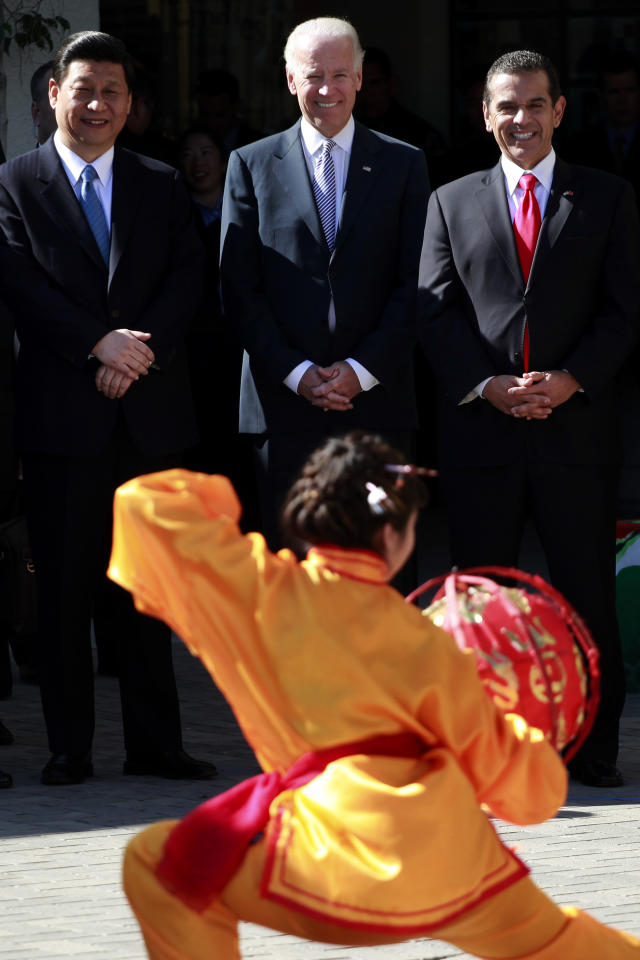 Vice President Joe Biden, center, Chinese Vice President Xi Jinping, left, and Los Angeles Mayor Antonio Villaraigosa, right, watch a dance performance during a visit to International Studies Learning Center Friday, Feb. 17, 2012 in South Gate, Calif. Chinese Vice President Xi Jinping began the last day of his U.S. visit Friday by urging closer ties and arguing that Americans benefit from their trade relationship with China. (AP Photo/Los Angeles Times, Jay L. Clendenin, Pool)